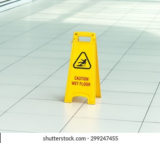 Yellow sign that alerts for wet floor in airport.