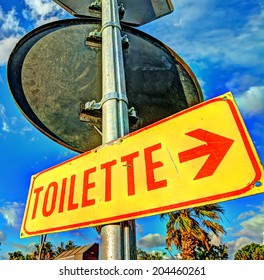 """yellow sign with """"toilette"""" writing"""