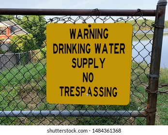 Yellow sign warning pedestrians not to walk in drinking water supply zone