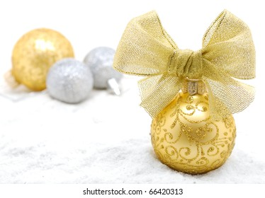 Yellow and silver christmas balls. Shallow depth of field