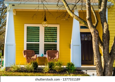 yellow single family home Real estate modern homes modern day living in Austin Texas suburb neighborhood