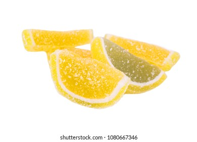 Yellow slices of marmalade isolated on white background. Marmalade in sugar. Orange taste marmalade