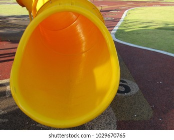 Yellow slide hole at children playground in Malaysia