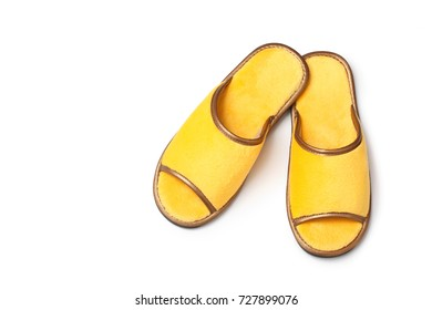 yellow slippers on white background