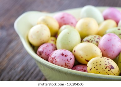 Yellow small easter eggs on a wooden rustic background
