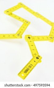 yellow small folding ruler on white background