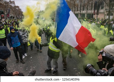 "Yellow smoke and a French flag during the ""Yellow Vests"" antigovernment protest in the French capital. Paris, France - December 8, 2018"