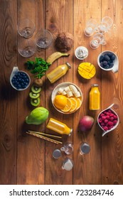 Yellow smoothie, Variety of fresh fruits for healthy eating or making yellow or green smoothie over rustic wooden background, top view. Healthy eating, vitamin, detox, diet food, clean eating concept
