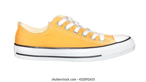 yellow sneakers isolated on white