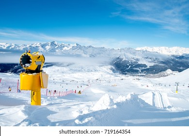 Yellow snow cannon (snow maker machine, snow gun) for production of snow on ski slopes - standard equipment device to create better skiing conditions or to extend the skiing season