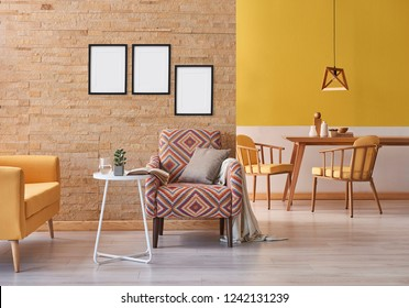 Yellow sofa brick wall and armchair close up decoration with white coffee table and wooden table dining room concept with wooden lamp background style frame picture decoration.
