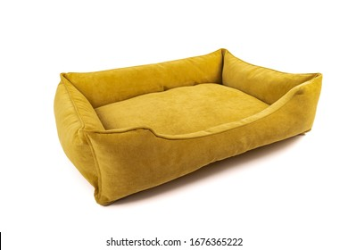 Yellow soft small dog or cats bed. Angle view.