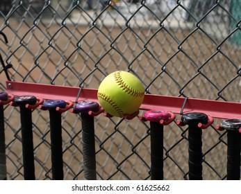 Yellow Softball and Bats