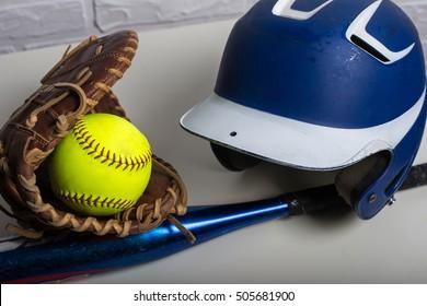 Yellow Softball, Helmet, Bat, and Glove  isolated on white background
