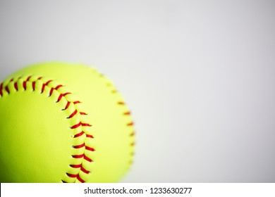 Yellow softball shot on a white background with macro lens