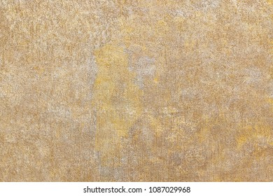 yellow sparkling wall with textured plaster