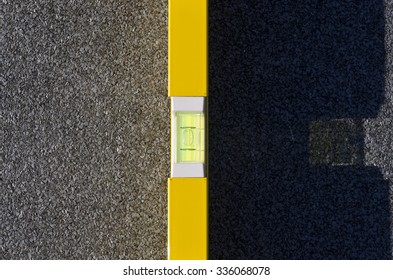 Yellow spirit level on a roof