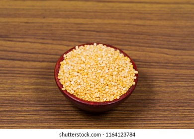 Yellow Split Dal Also know as Mogar Dal or Mung Dal isolated on wooden Background