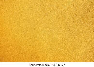 Yellow sponge surface texture background