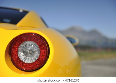 Yellow sports car light detail