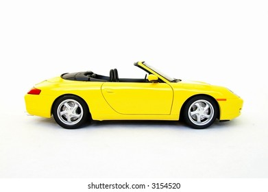 Yellow sports car model on white background