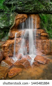 The Yellow Spring gushes water from an outcropping of rocks, stained orange yellow from high iron content, at Glen Helen Nature Preserve in Greene County, Ohio.
