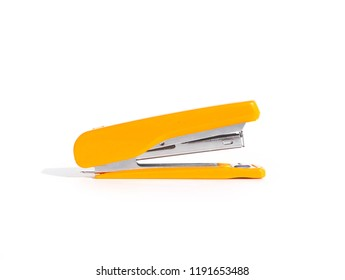 Yellow stapler isolated on a white background. Beside of tool picture.
