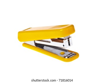 Yellow  stapler on a white background close-up (isolated).