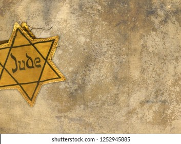Yellow star badge warn by Jews in concentration camp during world war II,copy space
