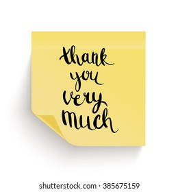 Yellow sticky note with the curled corner and adhesive tape, with handwritten phrase Thank you on white background.