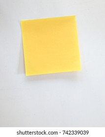 Yellow sticky note paper.