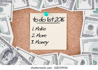 Yellow sticky reminder with 2016 TO DO LIST MAKE MORE MONEY message on corkboard with border made of 100 US dollars
