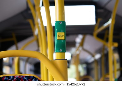 Yellow stop button in public transport