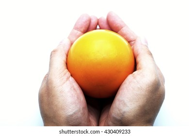 Yellow  stress ball in hands. Isolated on white background.