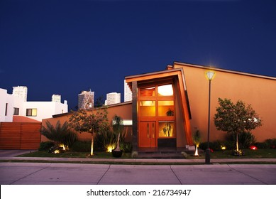 Yellow Suburban American Cape Cod Home with blu sky.