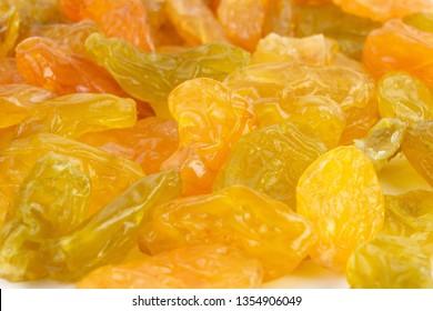 Yellow sultanas raisins isolated on white background cutout