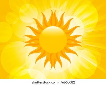 Yellow summer sun in a glowing orange summer sky