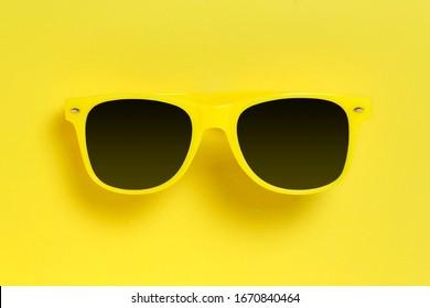 yellow sunglasses on yellow background