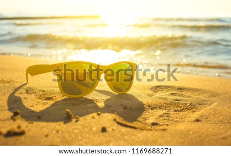 8a8b715191ce Yellow sunglasses on yellow sand beach with blue sea and sky background  summer