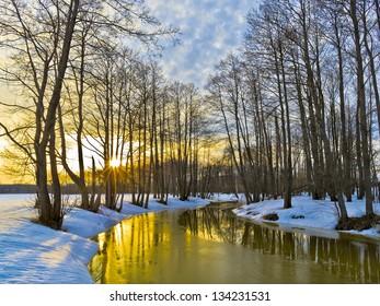 Yellow sunset in early spring. River Sukhodrev. Kaluga region. Russia