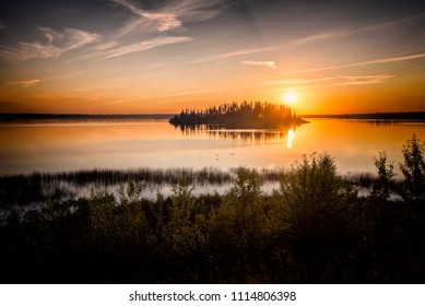 Yellow sunset over river with silhouette