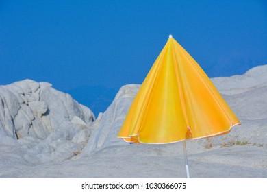 Yellow sunshade on the seashore