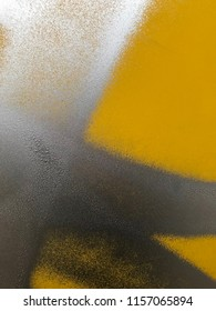 Yellow surface with silver metallic paint. Metal surface with abstrakt paint spots. Texture, closeup, wallpaper, background.
