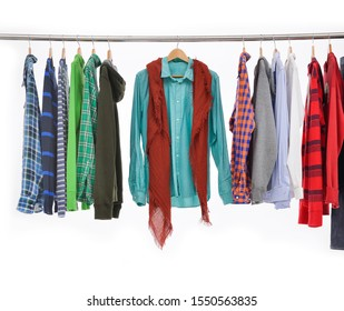 Yellow sweater and different orange hoodie and orange fashion Wind jacket with jeans jacket with blue shirts long sleeve plaid,scarf on hanger-wooden background