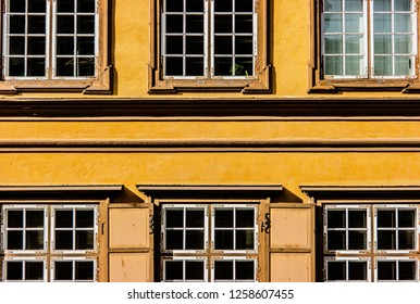 Yellow symmetrical old building front