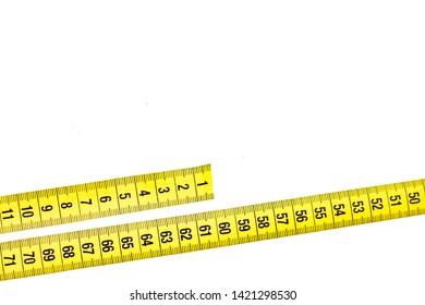 yellow tailor belt for waist measurement, measure lying on the table, close-up, empty space