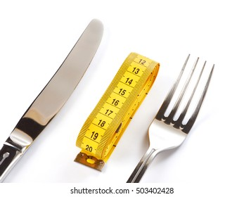 Yellow tailor meter, fork and knife isolated on white background