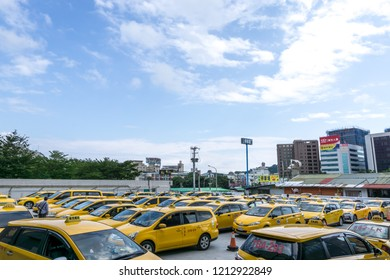 yellow taiwanese cabs parked in Hualien railway station parking lot. Taken in Hualien, Taiwan. October 23 2018