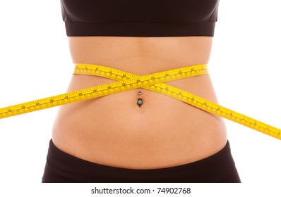 A yellow tape measure around a young females waist