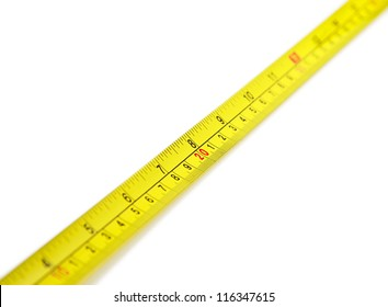 yellow tape measure on a white background with a focus on the number 20